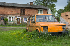 Old small car on a poor village Stock Photos