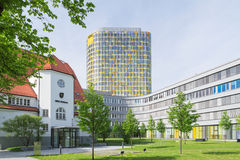 Old small clubhouse and the new ADAC Headquarters tower Stock Photo