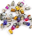 Old small colored light bulbs  on a white background Royalty Free Stock Photography