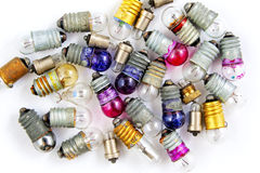 Old small colored light bulbs  on a white background Stock Photography