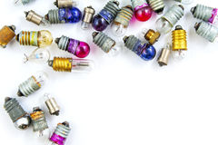 Old small colored light bulbs  on a white background Royalty Free Stock Image