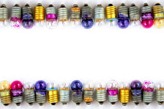 Old small colored light bulbs  on a white background Stock Images
