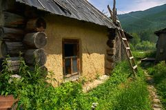 Old small house. And ladder Royalty Free Stock Image