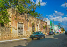 Old small houses at the colonial street in Mexico. Bright forsaken building in Mexican medieval town Valladolid Stock Image