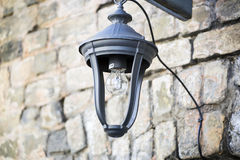 Old small lamp on the street. Stock Photo