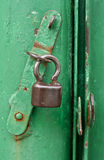 Old small lock. Old rustic green small lock Stock Image