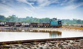 Old small locomotive and freight train Stock Images