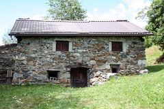 Old small mountain house in stone Stock Images