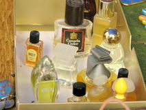 Old small perfumes for sale in a flea market Royalty Free Stock Image