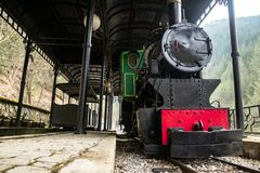 Old small steam locomotive in the train station stock images