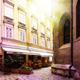 Old small street with Cafe terrace in vienna, austria Stock Photo