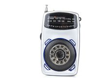 Old and small transistor radio on battery on the white. Old and small transistor radio on battery on the white Stock Images