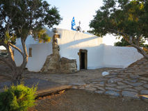 Old small white church with flag on Crete island, Greece Royalty Free Stock Photo