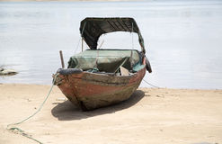 Old small wooden boat on beach Stock Image