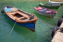 Old small wooden fishing boats moored in Bulgarian town Stock Photo