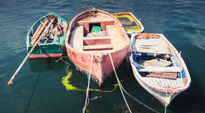 Old small wooden fishing boats moored in port. Of Avcilar, Istanbul, Turkey Stock Image