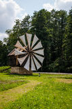 Old small wooden windmill near a forest Stock Photography
