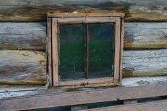 Old small wooden window in a rustic bath. stock photos