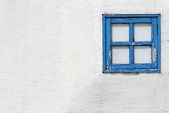 Old small wooden window. On the white wall Stock Photo