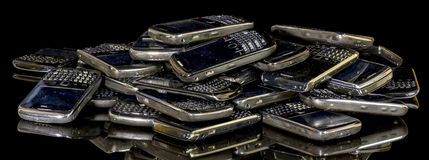 Old smart phones in a pile ready for recycle royalty free stock images