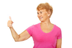An old smilig woman with thumb up Stock Image