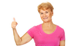 An old smilig woman with thumb up Stock Photography