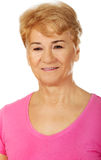 An old smiling charming woman Stock Images