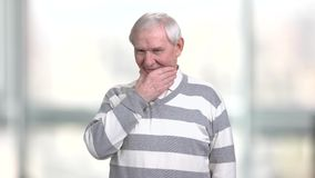 Old smiling man touching his chin. stock footage