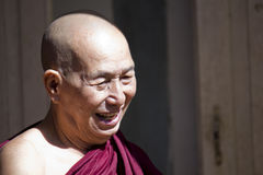 Old Smiling Monk Stock Image
