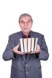 Old smiling professor holding a books Stock Photography