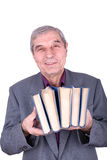 Old smiling professor holding a books Royalty Free Stock Photos