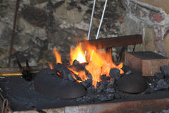 Old smithery and fire. As very nice background Royalty Free Stock Photo