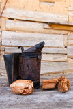 Old smoker at beehive Stock Photography