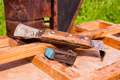 Old smoker and other tool of the beekeeper on the wooden box. Stock Photo