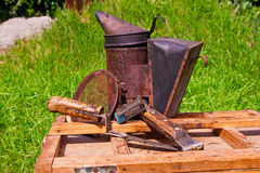 Old smoker and other tools on the wooden box. stock photography