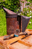 Old smoker on the wooden box. Stock Image