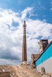 Old smokestack in old factory during demolation Royalty Free Stock Images