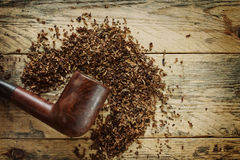 Old smoking pipe and tobacco Stock Photo