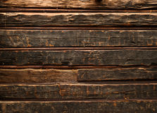 Old smutty log wall Stock Images