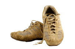 Old sneakers. Pair of old sneakers isolated on a white background Stock Images