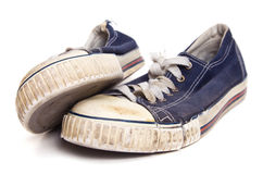 Old sneakers. Old canvas sneakers, isolated on white Royalty Free Stock Images