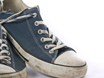Old Sneakers. A favorite pair of blue generic well worn old sneakers or tennis shoes Stock Photos