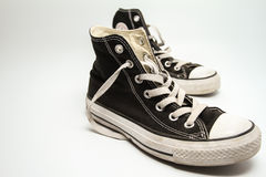Old sneakers. Black and dirty old style sneakers Stock Photography