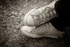 Old sneakers on the floor Royalty Free Stock Photography