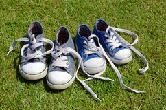 Old sneakers on grass background Royalty Free Stock Photos