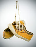 Old sneakers hanging Royalty Free Stock Photos