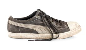 Old sneakers isolated Stock Photo