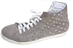 Old sneakers with studs Stock Image
