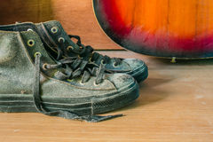 Old sneakers on a table Royalty Free Stock Photos