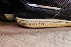 Old sneakers with the word sport Stock Photography